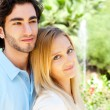 Portrait of love couple embracing outdoor in park looking happy — Stock Photo #7558680
