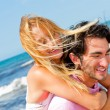 Stock Photo: An attractive couple fooling around on the beach
