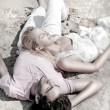Young couple relaxing on sand at beach and daydreaming with thei — Stock Photo