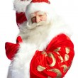 Santa Claus pointing his hand isolated over white. — Stock Photo #7558883