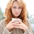 Portrait of young pretty red hair woman with cup of hot coffee o — Stock Photo