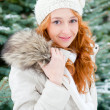 Portrait of young pretty woman in winter park — Stock Photo
