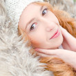 Portrait of pretty girl at winter background wearing warm clothe — Stock Photo #7559021