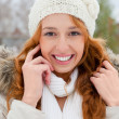 Portrait of beautiful young red hair woman outdoors in winter lo — Stock Photo