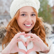 Portrait of beautiful young red hair woman outdoors in winter lo — Stock Photo #7559041