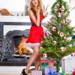 Christmas woman near a Christmas tree posing. Full length portra — Stock Photo #7559046