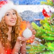 Royalty-Free Stock Photo: Poster of Christmas woman near a Christmas tree holding Christma