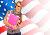 Portrait of pretty young woman holding book in her arms. USA Fla — Stock Photo