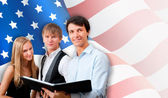 Group of young students standing with their teacher against Amer — Stock Photo