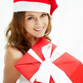 Young happy girl in Christmas hat — Stock Photo