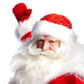 Santa Claus pointing his hand isolated over white. — Stock Photo
