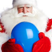 Traditional Santa Claus holding balloons for children. Isolated — Stockfoto