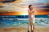 Portrait of young couple in love embracing at beach and enjoying — Stok fotoğraf