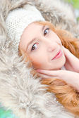 Portrait of pretty girl at winter background wearing warm clothe — Stock Photo