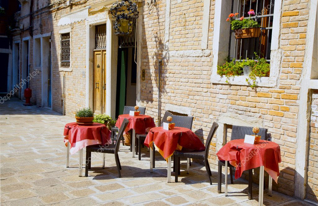 Terrace in the sun in front of a cafe  Stock Photo #7740302
