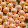 Beige colored beads background — Stockfoto