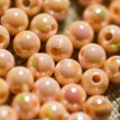Beige colored beads background - Stock Photo