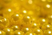 Gyllene gula pärlor abstrakt — Stockfoto
