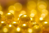 Golden Yellow Beads background — Stock Photo