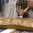 Artisan working with chisel - Stock Photo