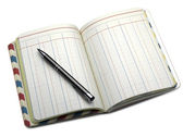 Open note book with lined pages and ballpoint pen — Stock Photo
