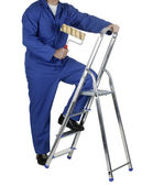 Professional painter standing on white background — Stock Photo