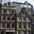 Holland, Amsterdam, the facade of old private stone houses — Stock Photo