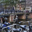 Royalty-Free Stock Photo: Holland, Amsterdam, bicycles parked by a bridge