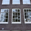 Stock Photo: Holland, Amsterdam, facade of old private stone house