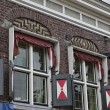 Holland, Volendam village (Amsterdam), old stone house facade - Stock Photo