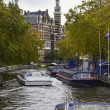 Holland, Amsterdam, ferryboats in one of the many canals - Stock Photo