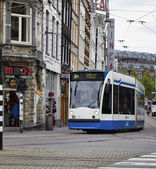 Holland, Amsterdam, tram and old buildings facades in a central street — Stock Photo