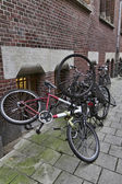 Holland, Amsterdam, bicycles parked in a central street — Stock Photo