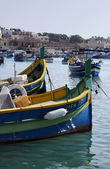 Malta Island, Marsaxlokk, wooden fishing boats in the harbor — Stock Photo