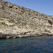 Malta,  Gozo Island, view of the southern rocky coastline of the island - Stock Photo