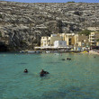 Stock Photo: Malta, Gozo Island, view of Xlendi bay with scubdivers
