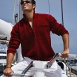 Italy, Tuscany, young sailor using a whinch on a sailing boat — Stock Photo #7913956