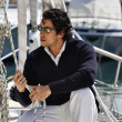 Stock Photo: Italy, Tuscany, young sailor dressed casual on sailing boat