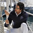 Italy, Tuscany, young sailor dressed casual on a sailing boat - Stock fotografie