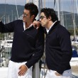 Italy, Tuscany, young sailors dressed casual on a sailing boat - Photo