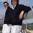 Italy, Tuscany, young sailors dressed casual on a sailing boat — Stock Photo