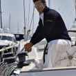 Stock Photo: Italy, Tuscany, young sailor dressed casual on a sailing boat