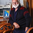 Italy, Tuscany, Viareggio port, mature sailor in his wooden boat - Photo