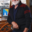 Italy, Tuscany, Viareggio port, mature sailor in his wooden boat - Foto Stock