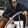 Italy, Tuscany, young sailor on a wooden sailing boat - Foto Stock