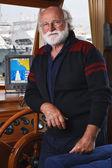 Italy, Tuscany, Viareggio port, mature sailor in his wooden boat — Stock Photo
