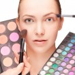 Woman with make-up and palette eyeshadow — Stockfoto