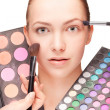 Woman with make-up and palette eyeshadow — Stock Photo