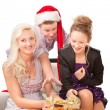 Young family having fun with Christmas presents. — Stock Photo #7864535