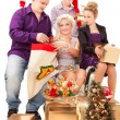 Young family having fun with Christmas presents. — Stock Photo #7864647